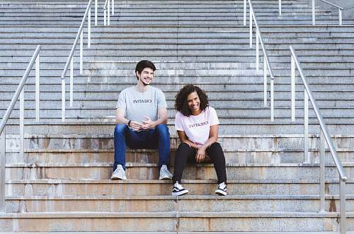 human man and woman sitting on stairs shoe