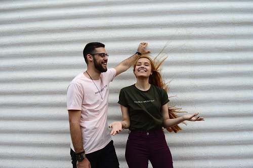 human man and woman standing while chatting apparel