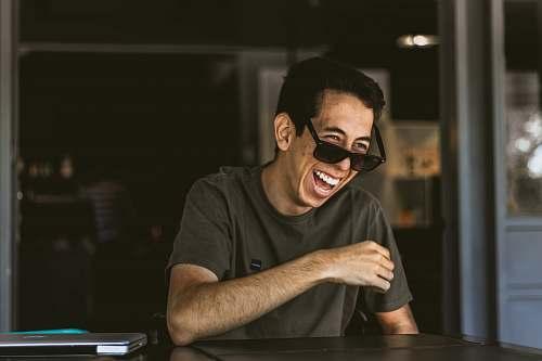 human man wearing sunglasses man