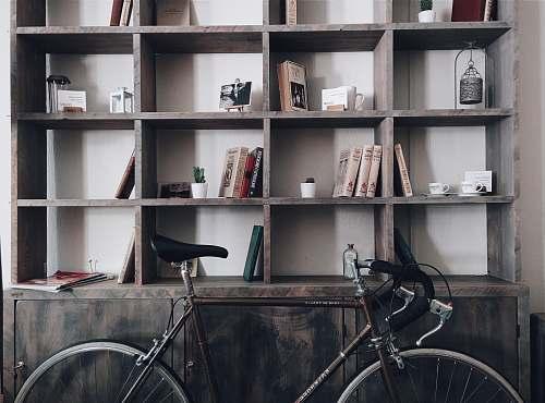 bike bicycle leaning on shelf bicycle