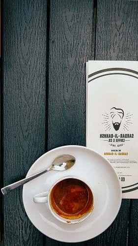 cutlery coffee in white ceramic mug near teaspoon pottery